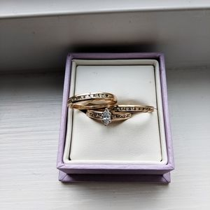 One engagement ring and two dimond bands